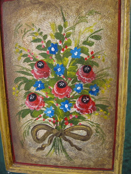 Painted flowers decorate a panel in the entry to the Cosmopolitan Hotel and Restaurant.