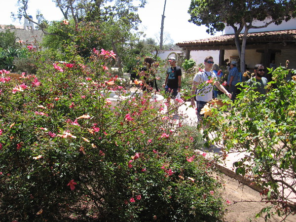 Visitors enjoy the lush, sunny courtyard of Casa de Estudillo.