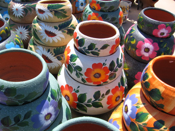 Flowers adorn pottery at El Centro Artesano.