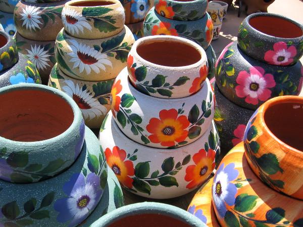 Flowers adorn pottery at El Centro Artesano.