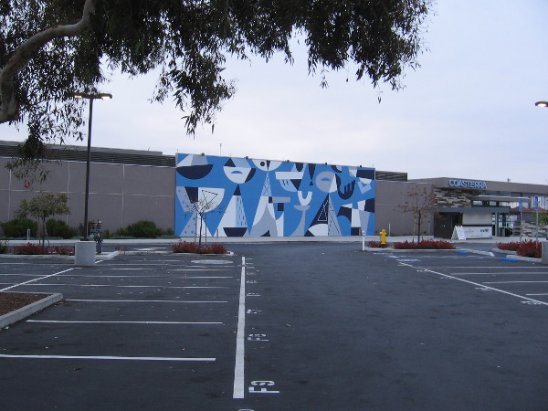 Photo of the cool mural across an empty early morning parking lot.