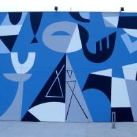 Lively mural by Rafael Lopez outside Coasterra!