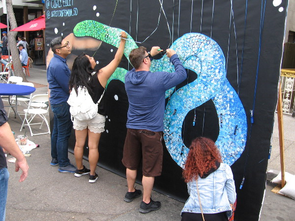 People were invited to work on this interactive mural sponsored by Artist and Craftsman Supply.