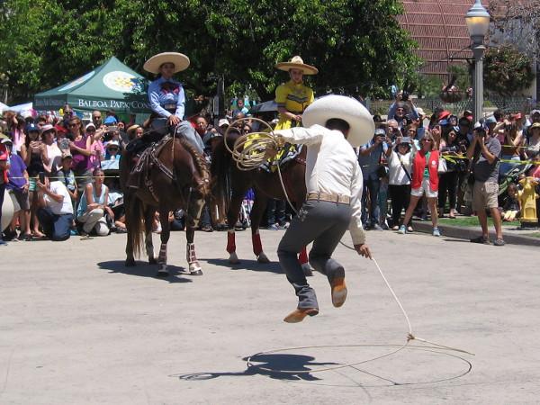Talented floreador Miguel Bautista performs rope tricks in Balboa Park during Cinco de Mayo!