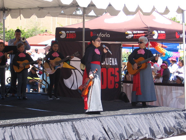 Buoyant traditional Mexican music is provided by City Heights Mariachi, an ensemble that welcomes all ages. They are actively seeking trumpet players!