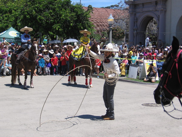 The equestrian group's floreador performs elaborate rope tricks for the crowd.
