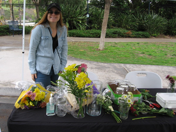 As I was leaving home in the morning, I spotted this nice lady setting up a table for the Jacaranda Flower Fest on Cortez Hill.