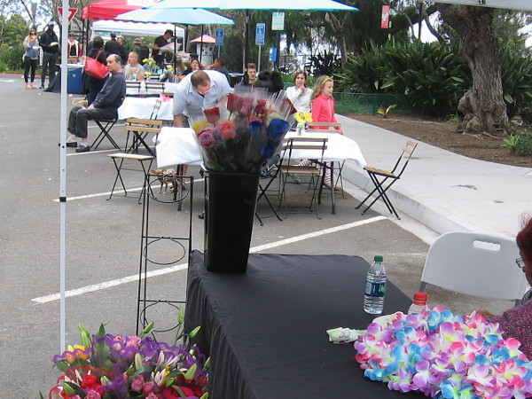 Later in the day, the Flower Fest was underway. Neighbors relax and enjoy a fun community event.
