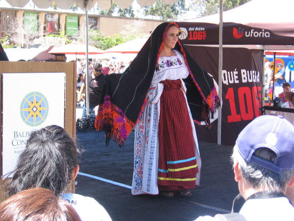 I believe this was said to be a dress from the Michoacán region. The shawl is an important aspect of the attire--it is used to send social signals.