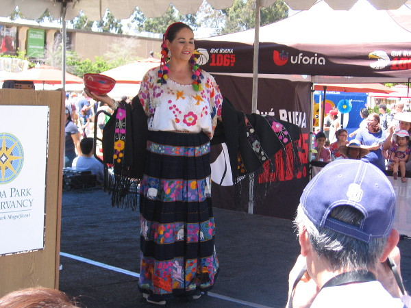 Dress from the Mexican state of Guerrero, if my notes are correct. Images in the fabric include flowers and jaguars.