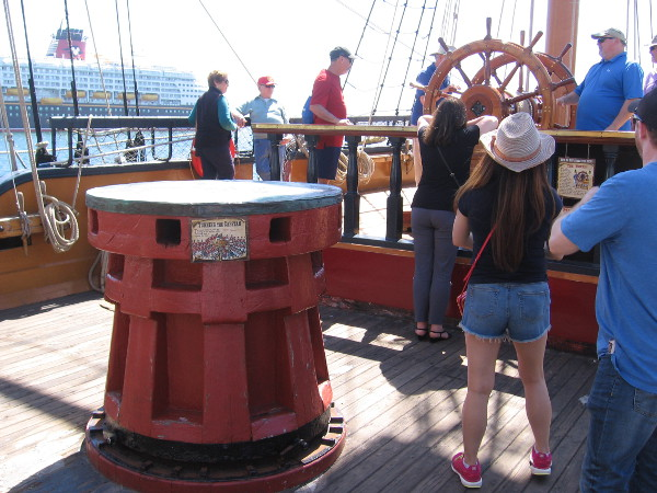 The Disney Wonder cruise ship is seen beyond the capstan. HMS Surprise was used in the filming of the movie Pirates of the Caribbean: On Stranger Tides.