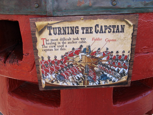 Many hands turned the capstan to raise or lower the anchor.