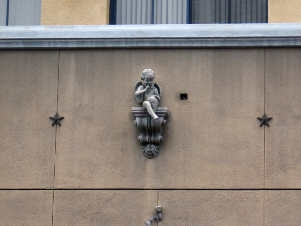 Sculpture of a winged cherub sits above a service entrance to the Horton Plaza shopping mall on Fourth Avenue.
