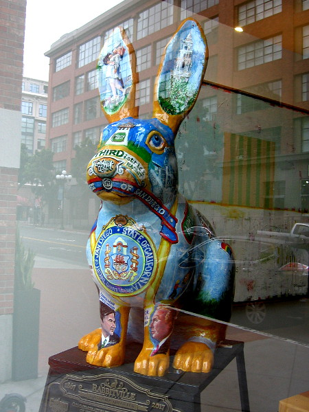 A colorful Rabbitville bunny inside a window of the Hilton Gaslamp.