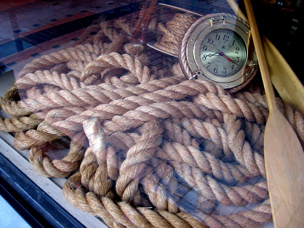 A tangle of rope inside the window of Crab Hut on Broadway.