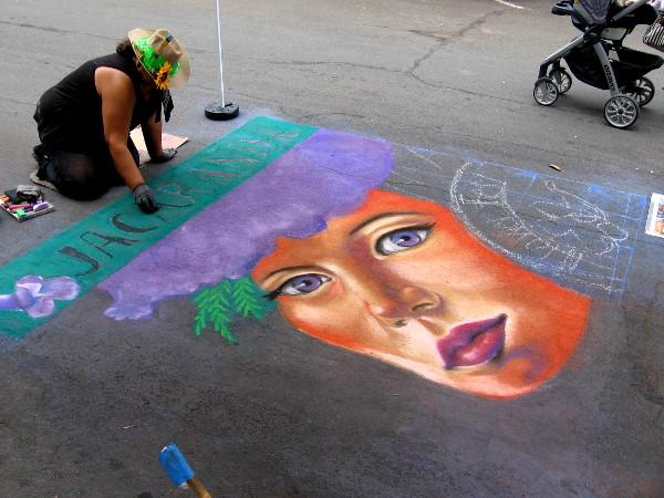 Local chalk artist Cecelia Linayao creates a beautiful jacaranda themed work of art on Date Street.