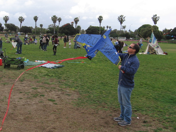 This guy has a cool U.S. Navy Blue Angels kite!