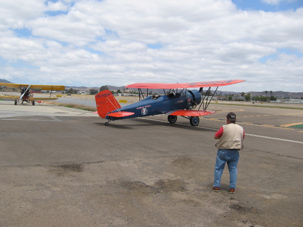 The first Stearman Speedmail biplane taxis out onto the runway.
