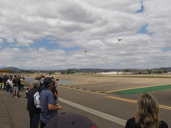 People watch as the Air Mail centennial celebration flight begins in San Diego!