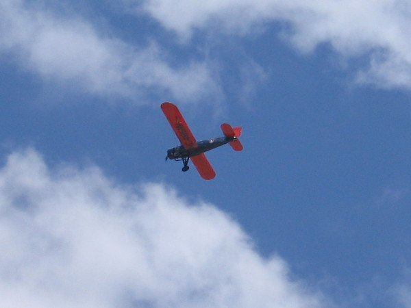 A vintage biplane plane flies north, beginning a 12-stop 1200-mile flight that retraces the Contract Mail 8 (CAM 8) air mail route.