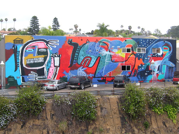 A photo of the colorful Myths at Play mural, painted by Lindu Prasekti.