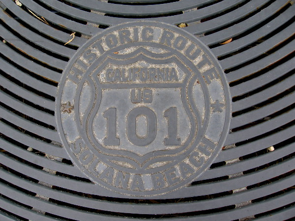 Grill in sidewalk marks historic U.S. Route 101 (also known as Pacific Coast Highway) where it passes through Solana Beach.