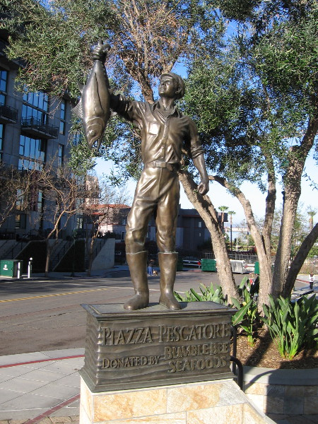 A bronze sculpture of a tuna fishermen holding his catch. Piazza Pescatore was donated by Bumble Bee Seafoods, which is headquartered in San Diego.