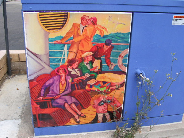 Nostalgic artwork on an electrical transformer on South Cedros Avenue shows people on the deck of a luxurious ship.