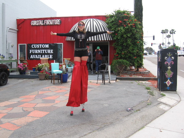 On my way back to the Solana Beach train station to catch the Coaster, I spied this friendly stiltwalker. She was telling passersby about a new gallery down the street in the Cedros Avenue Design District. (There's a glimpse of street art on a utility box. Stay tuned for much more!)