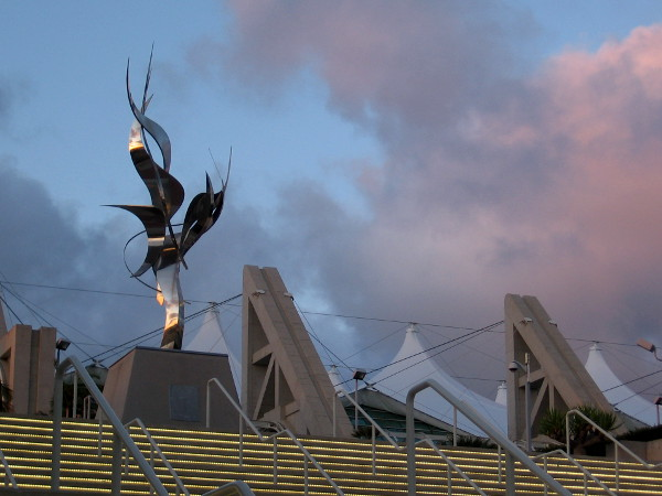 Leonardo Nierman's sculpture Flame of Friendship catches the sun's last rays as the lights come on at the San Diego Convention Center.