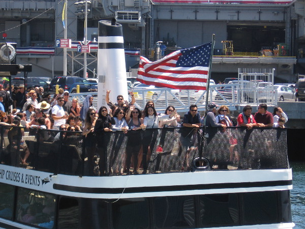 A bunch of happy people on the ferry to Coronado waved at me from beneath the ship's American flag.