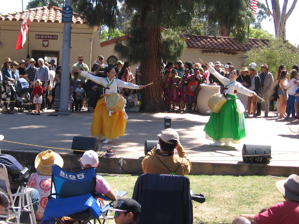Colorful dancers grace the outdoor stage at the International Cottages.