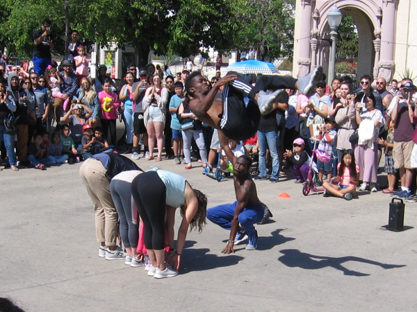Street entertainment delights a crowd in Balboa Park's Plaza de Panama.