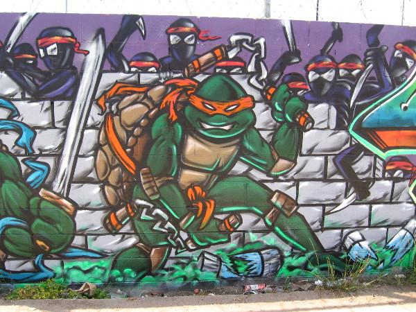 Michelangelo of the Teenage Mutant Ninja Turtles surrounded by enemies.