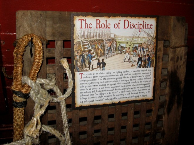 The complex often stressful operation of a man-of-war required strict discipline. Punishments included flogging and gagging.