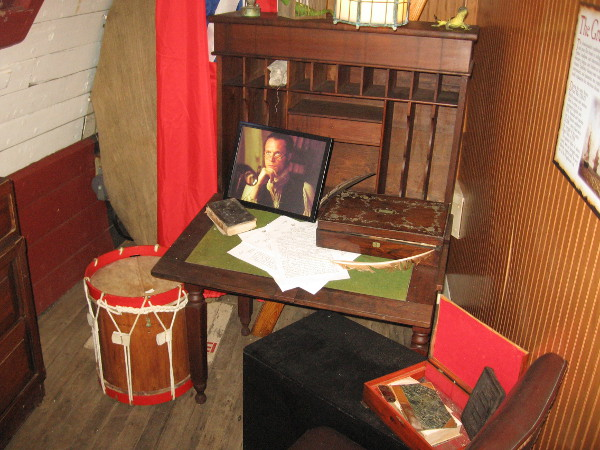 The doctor's quarters on the HMS Surprise. A photo shows actor Paul Bettany as the film's character Dr. Stephen Maturin.