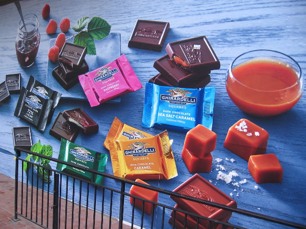 A graphic on a construction fence designed to make people drool! All these Ghirardelli treats and more will be returning to the Gaslamp!