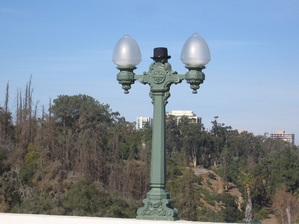 A top hat perched oddly atop a lamppost on the Cabrillo Bridge.