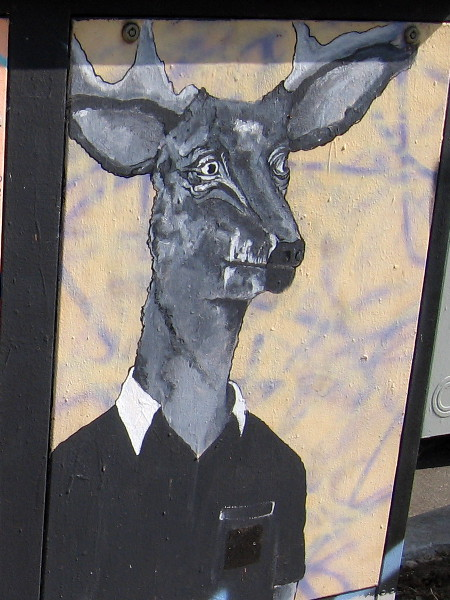 A deer dressed in a polo shirt. Humorous street art in Golden Hill.