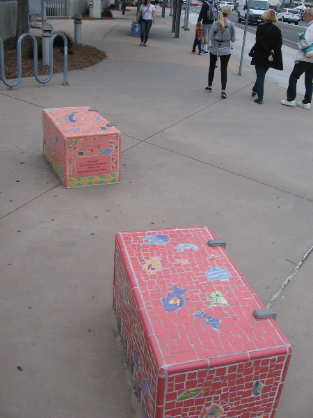 Two of eleven concrete benches decorated with images of marine life on Pacific Coast Highway, just north of Lomas Santa Fe Drive.
