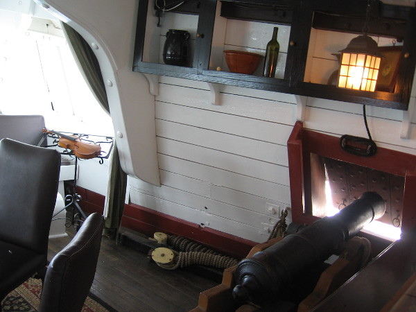 Historically, guns were deployed in the great cabin during battles at sea. To make room, furniture was removed and placed in a longboat which was then towed behind the ship!