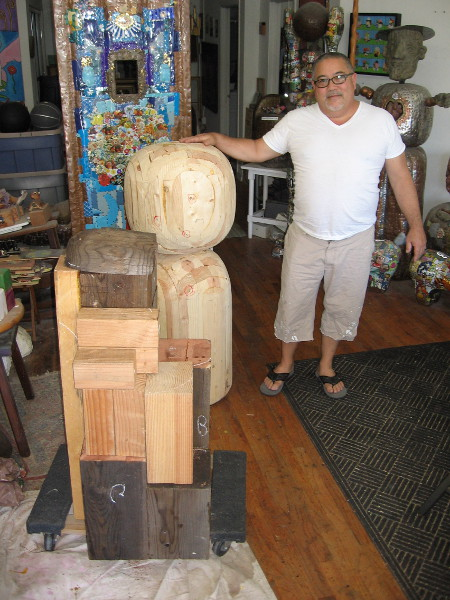 James Watts near some artwork in progress. The wood blocks will fill the interior of a hunchbacked Quasimodo. I was told a bell will be placed atop the literary character's head!