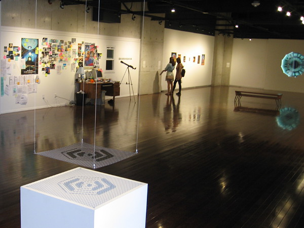 Visitors view artwork that concerns space travel and its effect on modern life, culture and human imagination.