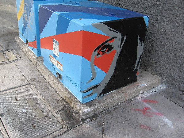A face painted by VISUAL on a transformer box in downtown San Diego. I photographed this (and the following two boxes) while walking down A Street.