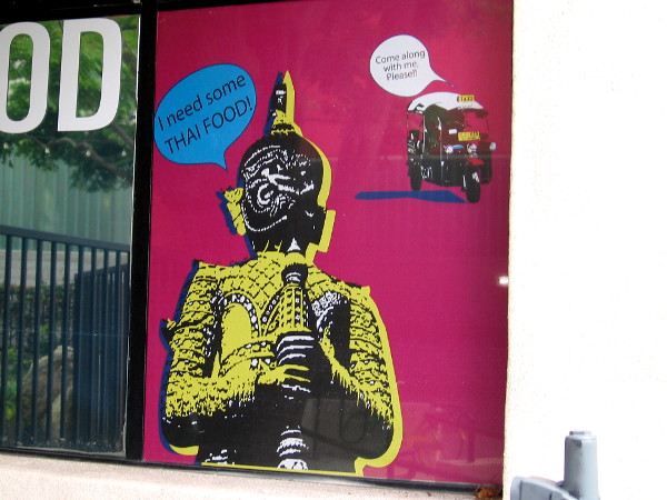All sorts of amusing graphics decorate the windows of the restaurant AAHARN by Koon Thai.