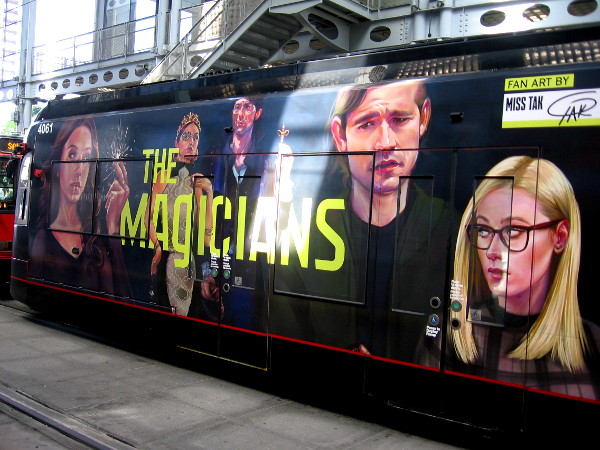 A Comic-Con trolley wrap that promotes The Magicians on Syfy.