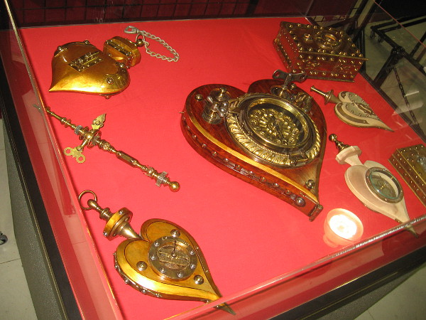 Many of Jeff's creations resemble lockets, or golden hearts with keys. Others resemble shining religious relics.