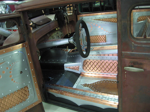 The car's interior is all hand-built copper and aluminum. 10,000 rivets were hammered into place.