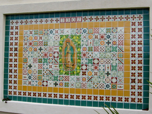 Beautiful tile mosaic with Virgin Mary at its center on a wall in North Park.