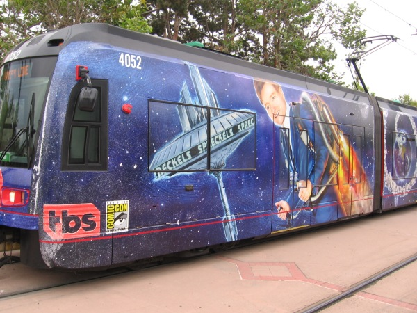 A trolley for 2018 San Diego Comic-Con has a wrap promoting the Conan show on TBS.